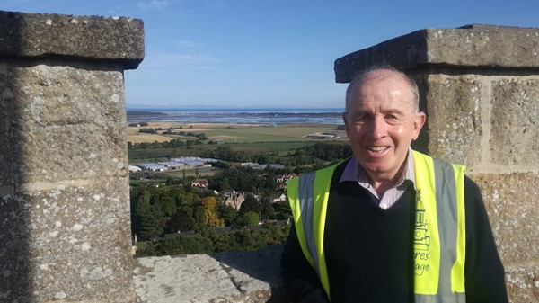 Volunteer Bill Dallas atop Nelson's Tower in Forres